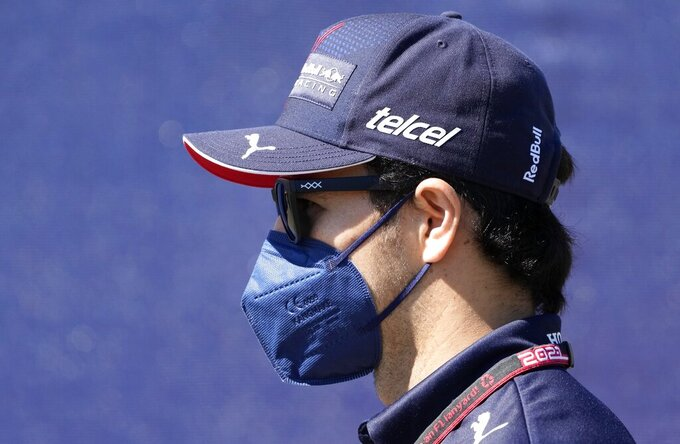 Red Bull driver Sergio Perez of Mexico arrives prior the third practice at the Red Bull Ring racetrack in Spielberg, Austria, Saturday, June 26, 2021. The Styrian Formula One Grand Prix will be held on Sunday, June 27, 2021. (AP Photo/Darko Vojinovic)