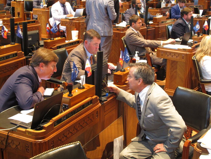 Reps. Jean-Paul Coussan, R-Lafayette, left; Stephen Dwight, R-Lake Charles, center; and Jerome