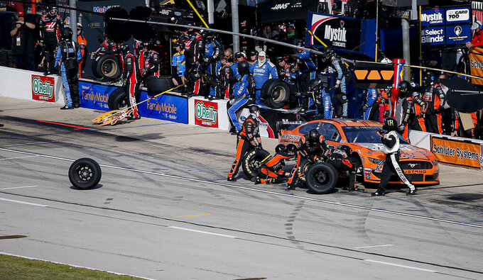 A tire gets loose from Corey LaJoie's pit crew during a NASCAR auto race at Texas Motor Speedway, Sunday, Nov. 3, 2019, in Fort Worth, Texas. (AP Photo/Brandon Wade)