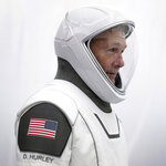 This undated photo made available by SpaceX shows NASA astronaut Doug Hurley in his spacesuit at SpaceX headquarters in Hawthorne, Calif. On Wednesday, May 27, 2020, Hurley and Bob Behnken are scheduled to pilot a SpaceX Dragon capsule to the International Space Station. It will be the first astronaut launch from NASA's Kennedy Space Center since the last shuttle flight in 2011. (Ashish Sharma/SpaceX via AP)