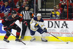 Carolina Hurricanes' Andrei Svechnikov (37), of Russia, chases Buffalo Sabres' Jeff Skinner (53) during the first period of an NHL hockey game in Raleigh, N.C., Friday, Jan. 11, 2019. (AP Photo/Gerry Broome)