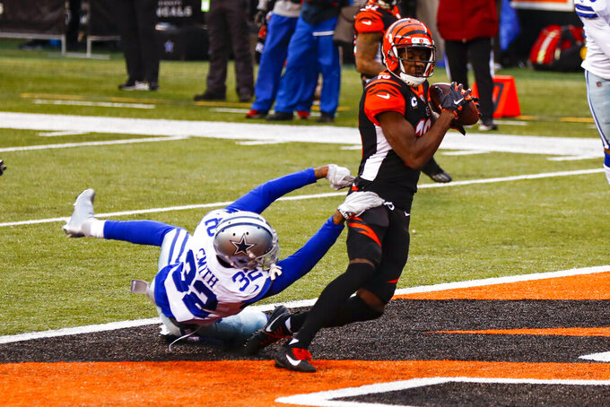 Cincinnati Bengals wide receiver A.J. Green (18) makes a catch for a touchdown over Dallas Cowboys cornerback Saivon Smith (32) in the first half of an NFL football game in Cincinnati, Sunday, Dec. 13, 2020. (AP Photo/Aaron Doster)