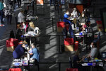 FILE - In this Feb. 11, 2021, file photo, people are administered COVID-19 vaccines at a vaccination center, at Gillette Stadium, in Foxborough, Mass. The U.S. death toll from COVID-19 has almost topped 500,000 — a number so staggering that a top health researchers says it is hard to imagine an American who hasn't lost a relative or doesn't know someone who died. (AP Photo/Steven Senne, File)