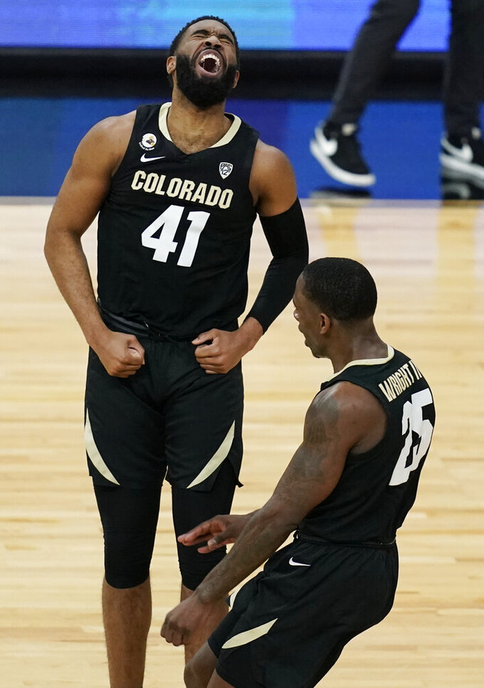 Colorado's Jeriah Horne (41) and McKinley Wright IV (25) celebrate after a play during the second half of an NCAA college basketball game against Southern California in the semifinal round of the Pac-12 men's tournament Friday, March 12, 2021, in Las Vegas. (AP Photo/John Locher)
