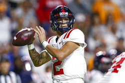 Mississippi quarterback Matt Corral (2) looks to a receiver during the first half of the team's NCAA college football game against Tennessee on Saturday, Oct. 16, 2021, in Knoxville, Tenn. (AP Photo/Wade Payne)