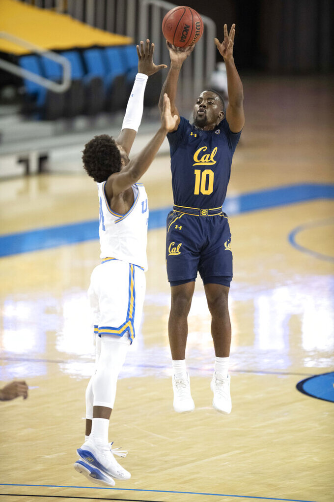 California guard Makale Foreman, right, shoots a three-point basket over UCLA guard David Singleton during the first half of an NCAA college basketball game Sunday, Dec. 6, 2020, in Los Angeles. (AP Photo/Kyusung Gong)