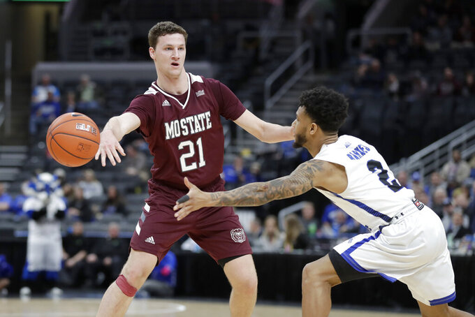 Missouri State's Ross Owens (21) passes around Indiana State's Jordan Barnes during the second half of an NCAA college basketball game in the quarterfinal round of the Missouri Valley Conference men's tournament Friday, March 6, 2020, in St. Louis. (AP Photo/Jeff Roberson)