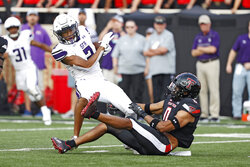 Texas Tech's Seth Collins (0) tackles Stephen F. Austin's Xavier Gipson (2) during the first half of an NCAA college football game Saturday, Sept. 11, 2021, in Lubbock, Texas. (AP Photo/Brad Tollefson)