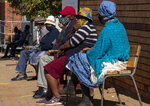 Retirees wait to receive a first dose of the Pfizer coronavirus vaccine in a tent during a mass vaccination program for the elderly at a clinic outside Johannesburg, South Africa, Monday, May 24, 2021. South Africa aims to vaccinate 5 million of its older citizens by the end of June. (AP Photo/Themba Hadebe)