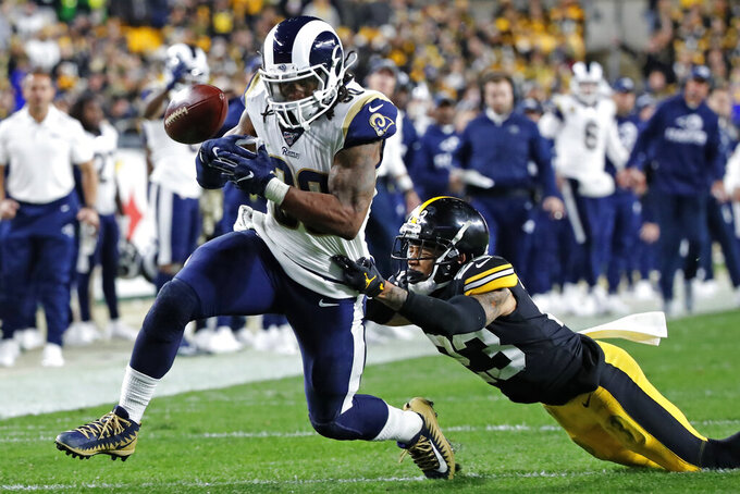 Los Angeles Rams running back Todd Gurley (30) loses the ball as he is tackled by Pittsburgh Steelers cornerback Joe Haden (23) during the second half of an NFL football game in Pittsburgh, Sunday, Nov. 10, 2019. The ball went out of bounds on the play. (AP Photo/Don Wright)