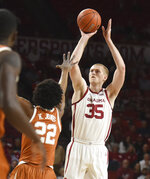 Oklahoma forward Brady Manek (35) shoots the ball over Texas forward Kai Jones (22) during the first half of an NCAA college basketball game in Norman, Okla., Tuesday, March 3, 2020. (Kyle Phillips/The Norman Transcript via AP)