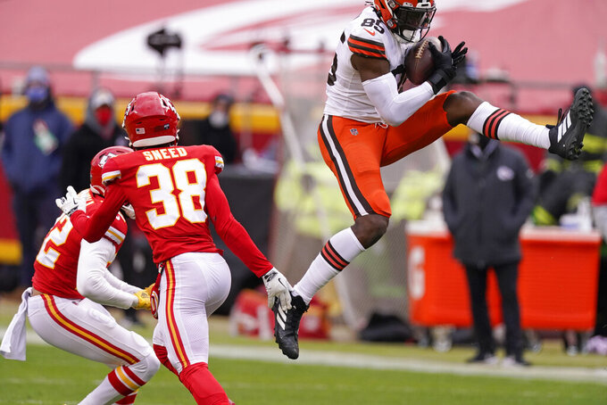 Cleveland Browns tight end David Njoku, right, catches a pass over Kansas City Chiefs safety L'Jarius Sneed (38) during the first half of an NFL divisional round football game, Sunday, Jan. 17, 2021, in Kansas City. (AP Photo/Charlie Riedel)