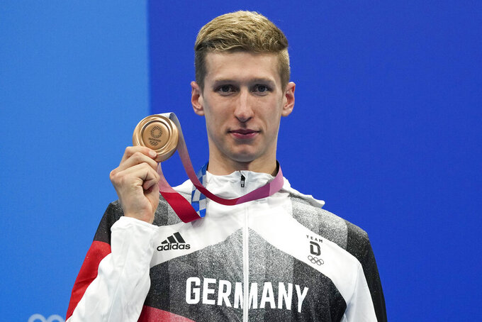 Florian Wellbrock, of Germany, celebrates after winning the bronze medal in a men's 1500-meter freestyle final at the 2020 Summer Olympics, Sunday, Aug. 1, 2021, in Tokyo, Japan. (AP Photo/Gregory Bull)