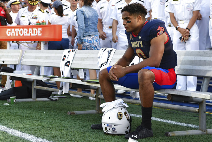 Navy fullback Chance Warren looks on from the bench after losing to Air Force after an NCAA college football game, Saturday, Sept. 11, 2021, in Annapolis, Md. (AP Photo/Terrance Williams)