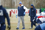 Tennessee Titans head coach Mike Vrabel walks among players as they stretch during an NFL football practice Friday, Jan. 17, 2020, in Nashville, Tenn. The Titans are scheduled to face the Kansas City Chiefs in the AFC Championship game Sunday. (AP Photo/Mark Humphrey)