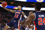 Auburn guard J'Von McCormick (12) drives to the basket against Kansas guard Marcus Garrett (0) during the first half of a second-round game in the NCAA men's college basketball tournament Saturday, March 23, 2019, in Salt Lake City. (AP Photo/Jeff Swinger)
