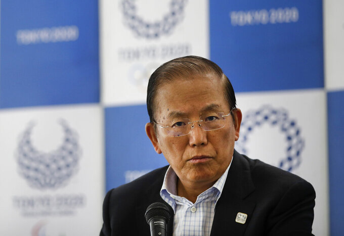 In this June 11, 2019, file photo, Toshiro Muto, CEO of the 2020 Tokyo Olympics organizing committee, listens to questions from the media during a news conference in Tokyo. Tokyo CEO Muto and other Olympic officials are proposing that the government relax immigration regulations, allowing athletes to enter the country before next year's postponed games and train during a 14-day quarantine period. (AP Photo/Jae C. Hong, File)
