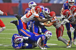 The Kansas City Chiefs defense tackles Buffalo Bills quarterback Josh Allen, center, during the first half of an NFL football game, Monday, Oct. 19, 2020, in Orchard Park, N.Y. (AP Photo/Adrian Kraus)