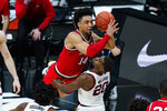 Ohio State forward Justice Sueing (14) draws the foul from Illinois guard Da'Monte Williams (20) during the second half of an NCAA college basketball championship game at the Big Ten Conference tournament, Sunday, March 14, 2021, in Indianapolis. (AP Photo/Michael Conroy)