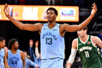 Memphis Grizzlies forward Jaren Jackson Jr. (13) gestures to the crowd after scoring a three-point basket in the second half of an NBA basketball game against the Milwaukee Bucks, Friday, Dec. 13, 2019, in Memphis, Tenn. (AP Photo/Brandon Dill)