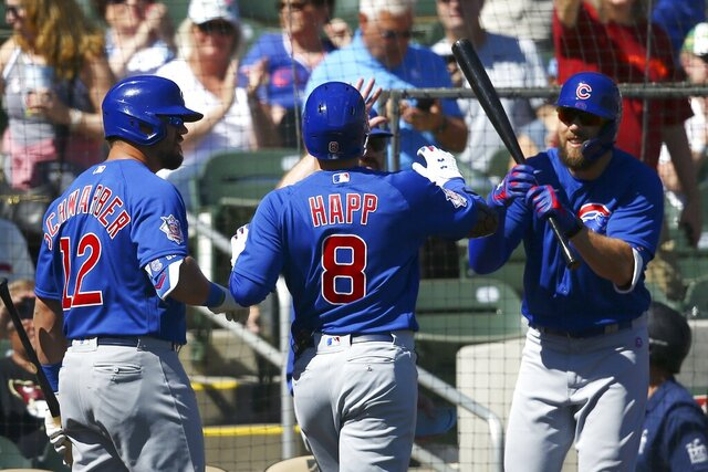 Chicago Cubs' Ian Happ (8) celebrates his home run against the Colorado Rockies with Kyle Schwarber (12) and Steven Souza Jr., right, during the first inning of a spring training baseball game Tuesday, March 3, 2020, in Scottsdale, Ariz. (AP Photo/Ross D. Franklin)