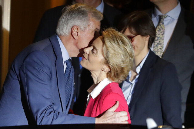 European Commission President Ursula von der Leyen kisses EU Chief Negotiator on Brexit Michael Barnier on the cheek as they depart 10 Downing Street following a meeting with Britain's Prime Minister Boris Johnson in London, Wednesday, Jan. 8, 2020. (AP Photo/Kirsty Wigglesworth)