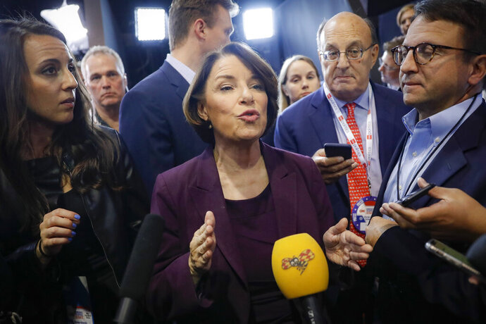 Democratic presidential candidate Sen. Amy Klobuchar, D-Minn., speaks to media in the spin room following a Democratic presidential primary debate hosted by CNN/New York Times at Otterbein University, Tuesday, Oct. 15th, 2019, in Westerville, Ohio. (AP Photo/John Minchillo)