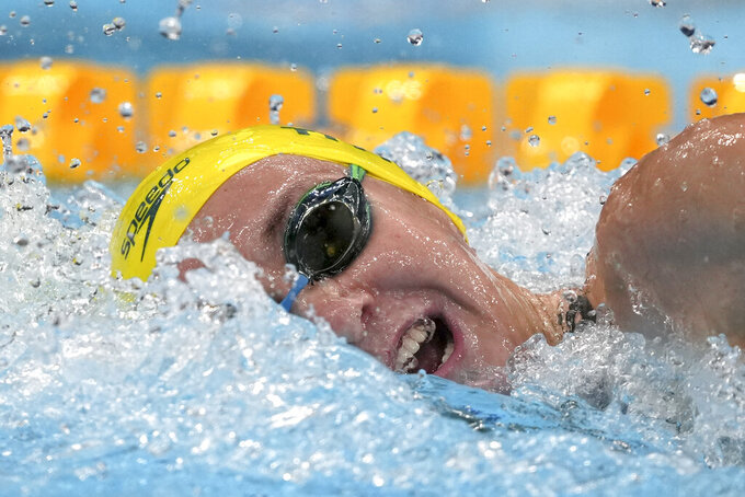 Ariarne Titmus of Australia swims in a women's 200-meter freestyle final at the 2020 Summer Olympics, Wednesday, July 28, 2021, in Tokyo, Japan. (AP Photo/Matthias Schrader)