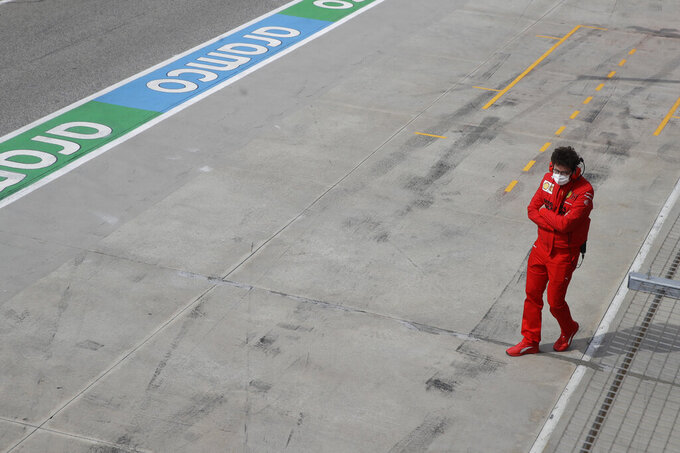 Ferrari sport director Mattia Binotto walks the pit lane during free practice for Sunday's Emilia Romagna Formula One Grand Prix, at the Imola track, Italy, Saturday, April 17, 2021. (AP Photo/Luca Bruno)