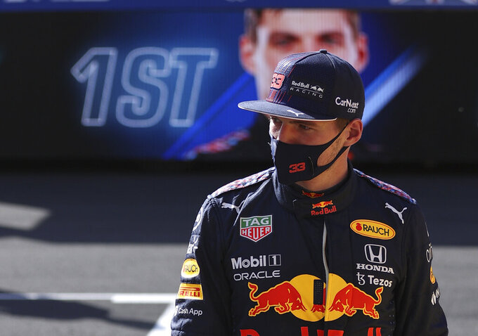 Red Bull driver Max Verstappen of the Netherlands walks after finishing first in the Sprint Qualifying of the British Formula One Grand Prix, at the Silverstone circuit, in Silverstone, England, Saturday, July 17, 2021. The British Formula One Grand Prix will be held on Sunday. (Lars Baron/Poolvia AP)