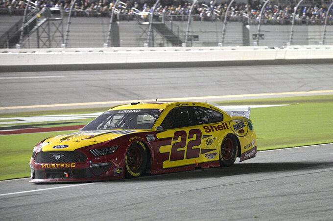 Joey Logano (22) makes his way down pit road during a NASCAR Cup Series auto race at Daytona International Speedway, Saturday, Aug. 28, 2021, in Daytona Beach, Fla. (AP Photo/Phelan M. Ebenhack)