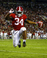 Alabama running back Damien Harris (34) leaps into the end zone for a touchdown during the second half of an NCAA college football game against Missouri, Saturday, Oct. 13, 2018, in Tuscaloosa, Ala. Alabama won 39-10. (AP Photo/Butch Dill)
