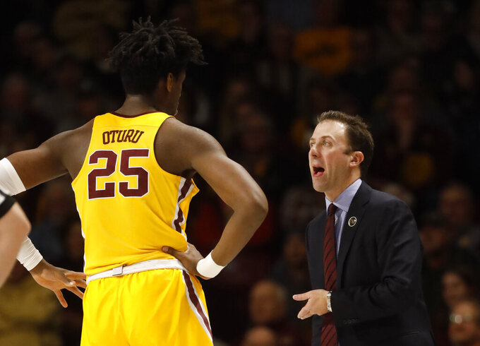 FILE - In this Jan. 8, 2019, file photo, Minnesota head coach Richard Pitino talks with Daniel Oturu (25) as his team plays Maryland during an NCAA college basketball game in Minneapolis. After posting the first NCAA Tournament victory in years under Pitino, Minnesota must replace its two best players in Jordan Murphy and Amir Coffey. (AP Photo/Bruce Kluckhohn, File)