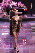Model Irina Shayk wears a creation as part of the Versace men's Spring-Summer 2020 collection, unveiled during the fashion week, in Milan, Italy, Saturday, June 15, 2019. (AP Photo/Luca Bruno)