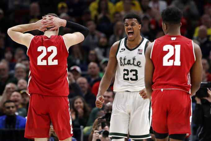 Michigan State's Xavier Tillman (23) reacts during the first half of an NCAA college basketball game against Wisconsin in the semifinals of the Big Ten Conference tournament, Saturday, March 16, 2019, in Chicago. (AP Photo/Nam Y. Huh)