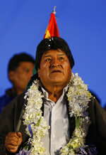 Bolivia's President Evo Morales stands before supporters at an event celebrating his reelection in El Alto, Bolivia, Monday, Oct. 28, 2019. Morales' backers and foes are blocking streets and highways across the country in a dispute over official election results that show the leftist leader winning reelection without a runoff. (AP Photo/Juan Karita)