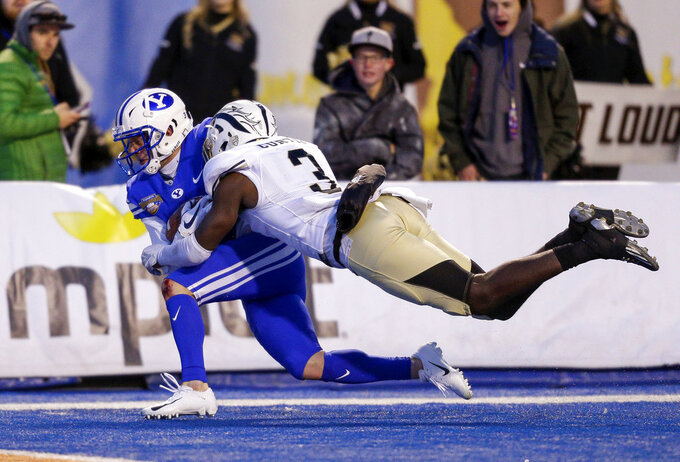 BYU wide receiver Dylan Collie, left, is tackled by Western Michigan defensive back Anton Cutris (3) after a 41-yard reception late in the second half of the Famous Idaho Potato Bowl NCAA college football game, Friday, Dec. 21, 2018, in Boise, Idaho. (AP Photo/Steve Conner)