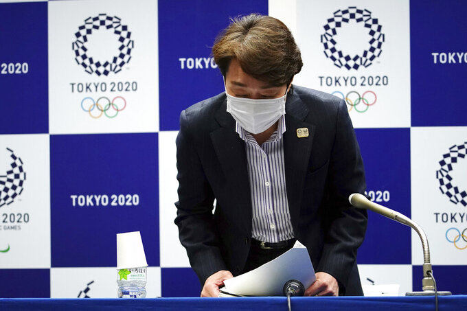 Seiko Hashimoto, president of the Tokyo 2020 Organizing Committee of the Olympic and Paralympic Games, greets after a press conference Friday, March 19, 2021, in Tokyo. (AP Photo/Eugene Hoshiko, Pool)