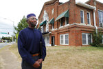 In this Oct. 15, 2019, photo, Imam Talib Salahuddin stands in front of his Mosque, rear, which sits next door to the home of Atatiana Jefferson, as he responds to questions during an interview in Fort Worth, Texas. Former Fort Worth Police officer Aaron Dean shot Jefferson through a back window around 2:30 a.m. after a neighbor reported her front door was left open. Salahuddin recalled the young woman as having a