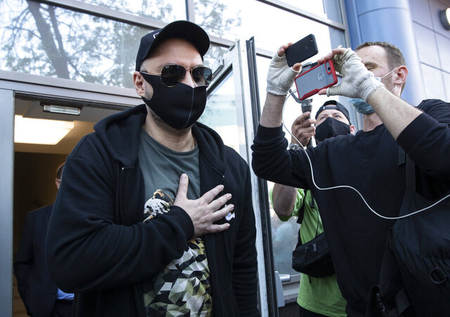 Russian film and theater director Kirill Serebrennikov, wearing a face mask to protect against coronavirus, leaves the Meshchansky court after hearings in Moscow, Russia, Friday, June 26, 2020. (AP Photo/Pavel Golovkin)
