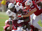 Bethune-Cookman running back Isaac Washington (34) is tackled by Nebraska linebacker Mohamed Barry, left, linebacker Caleb Tannor (4) and defensive lineman Ben Stille (95) during the first half of an NCAA college football game in Lincoln, Neb., Saturday, Oct. 27, 2018. (AP Photo/Nati Harnik)