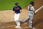 Minnesota Twins' Jake Cave, left, scores next to Detroit Tigers catcher Austin Romine during the fifth inning of a baseball game Saturday, Sept. 5, 2020, in Minneapolis. (AP Photo/Jim Mone)