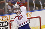 Montreal Canadiens goaltender Carey Price stretches to catch the puck flying in the air during the first period of an NHL hockey game against the Florida Panthers on Sunday, Feb. 17, 2019, in Sunrise, Fla. (AP Photo/Brynn Anderson)