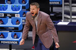 Alabama head coach Nate Oats gives instructions against UCLA in the first half of a Sweet 16 game in the NCAA men's college basketball tournament at Hinkle Fieldhouse in Indianapolis, Sunday, March 28, 2021. (AP Photo/Michael Conroy)