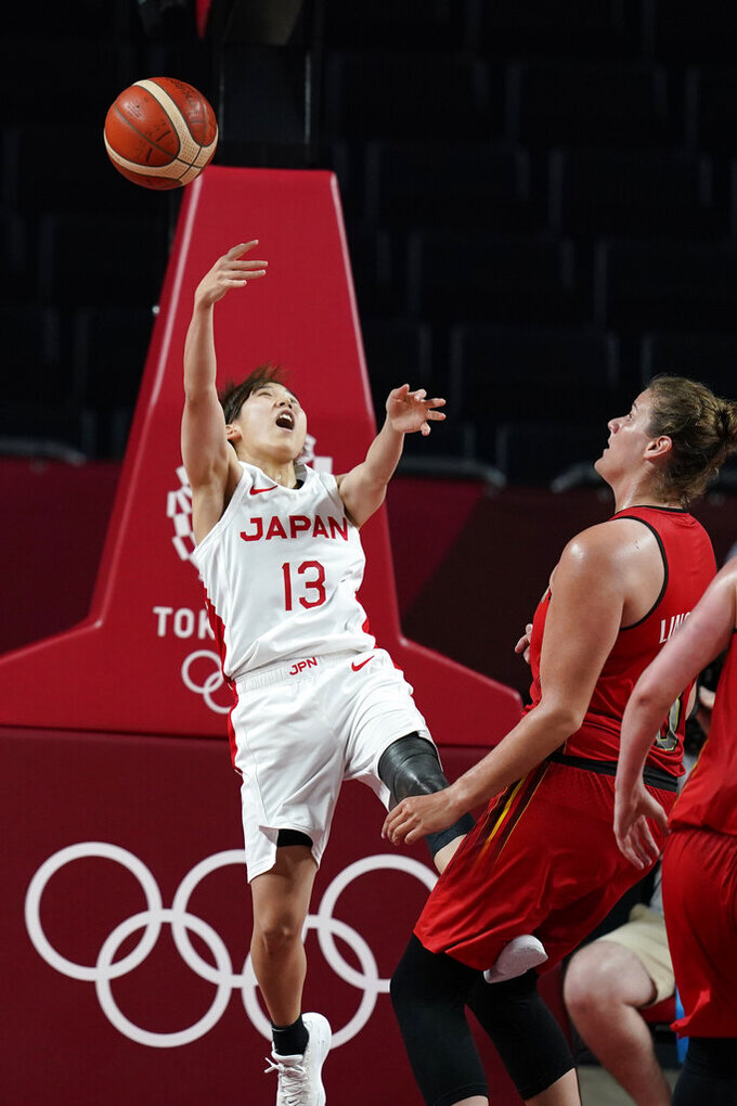 Japan's Rui Machida (13) is fouled by Belgium's Kyara Linskens, right, while driving to the basket during a women's basketball quarterfinal round game at the 2020 Summer Olympics, Wednesday, Aug. 4, 2021, in Saitama, Japan. (AP Photo/Charlie Neibergall)