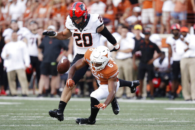 Oklahoma State safety Malcolm Rodriguez (20) breaks up a pass intended for Texas wide receiver Devin Duvernay (6) during the first half of an NCAA college football game Saturday, Sept. 21, 2019, in Austin, Texas. (AP Photo/Eric Gay)