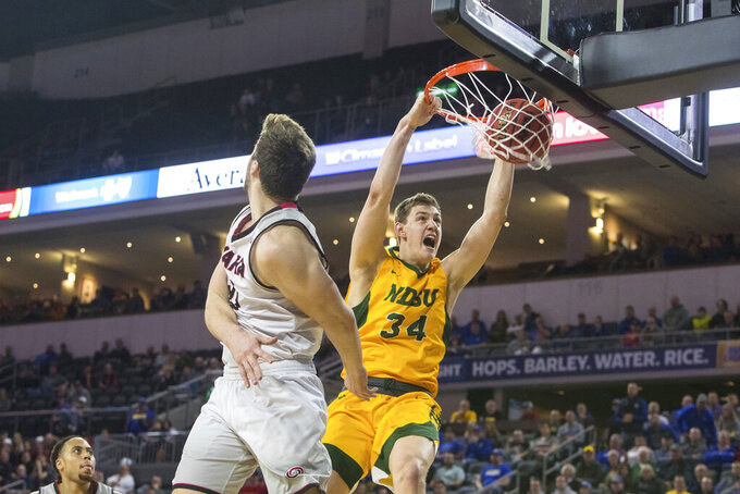 North Dakota State's Rocky Kreuser (34) dunks against Omaha during an NCAA college basketball game for the Summit League men's tournament championship, Tuesday, March 12, 2019, in Sioux Falls, S.D. (Loren Townsley/Argus Leader via AP)