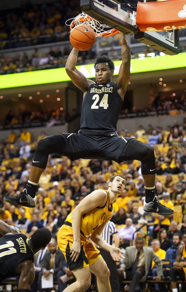 Vanderbilt's Aaron Nesmith (24) dunks the ball over Missouri's Reed Nikko, bottom, during the first half of an NCAA college basketball game Saturday, Feb. 2, 2019, in Columbia, Mo. (AP Photo/L.G. Patterson)