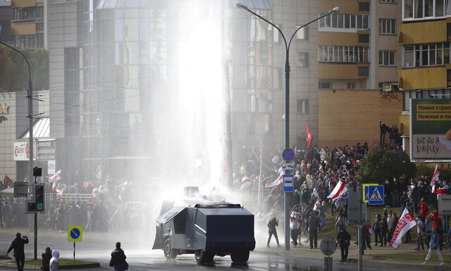 Police use a water cannon toward demonstrators during a rally in Minsk, Belarus, Sunday, Oct. 4, 2020. Hundreds of thousands of Belarusians have been protesting daily since the Aug. 9 presidential election. (AP Photo)
