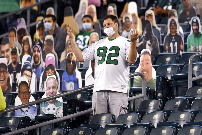 A Philadelphia Eagles' fan reacts during the first half of an NFL football game against the New York Giants, Thursday, Oct. 22, 2020, in Philadelphia. (AP Photo/Derik Hamilton)